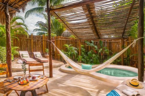 The swimming pool at or near Viceroy Riviera Maya - Luxury Resort