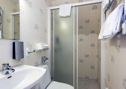 Ett badrum på Hotel Bellevue