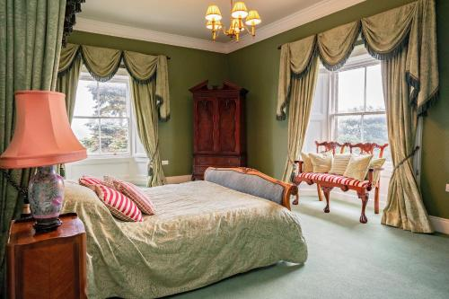 A bed or beds in a room at Netley Hall Hotel