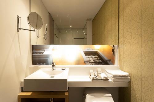 Salle de bains dans l'établissement Hotel bh Bicentenario