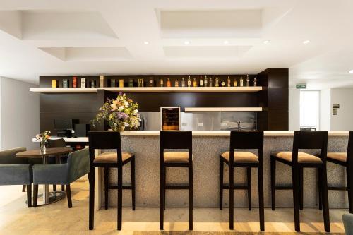 Restaurant ou autre lieu de restauration dans l'établissement Hotel bh Bicentenario