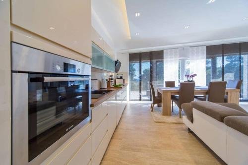 A kitchen or kitchenette at Villa Mlini with private Pool and Sea view