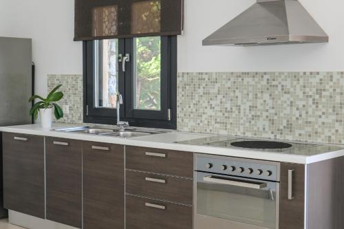 Kjøkken eller kjøkkenkrok på Golden King Villas