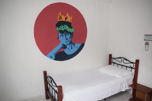 A bed or beds in a room at Deportel Cali