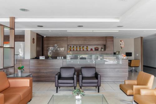 The lobby or reception area at Citi Hotel Residence Caruaru