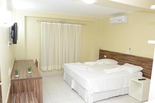 Cama ou camas em um quarto em Requinte Hotel