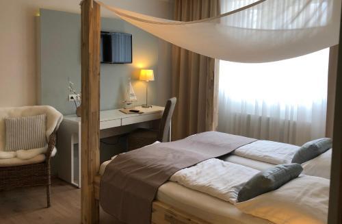 Ein Bett oder Betten in einem Zimmer der Unterkunft Hotel Restaurant FIDI