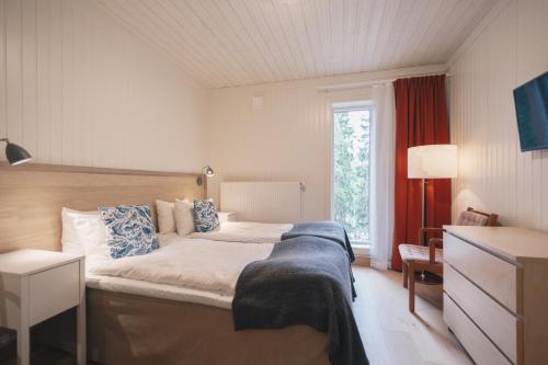 Säng eller sängar i ett rum på Granö Beckasin