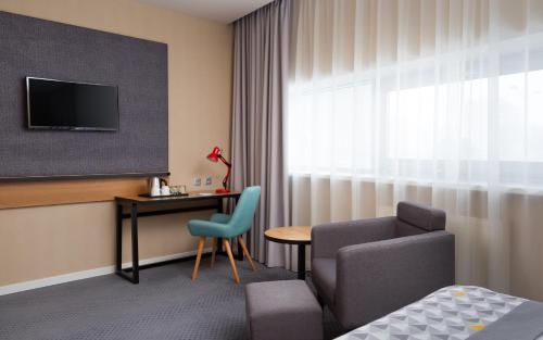 Телевизор и/или развлекательный центр в Holiday Inn Perm