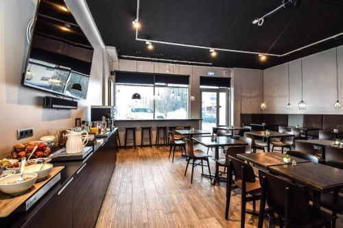 A restaurant or other place to eat at Bella Apartments & Rooms