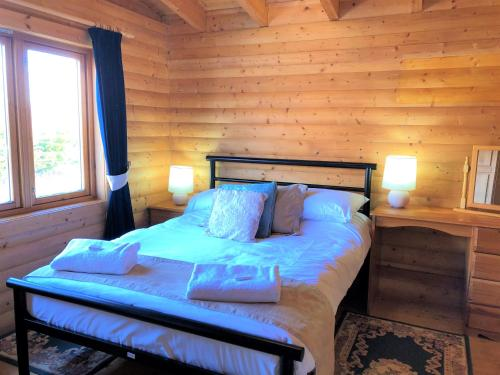 A bed or beds in a room at Glenbeag Mountain Lodges
