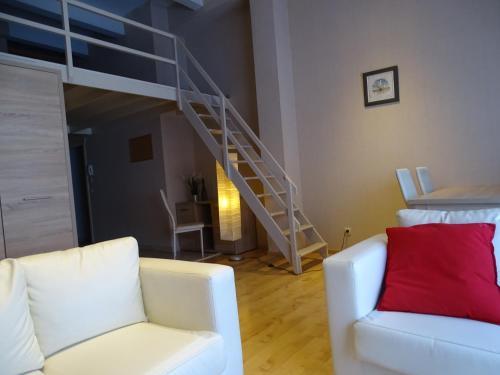 A seating area at Ambassador Suites Leuven