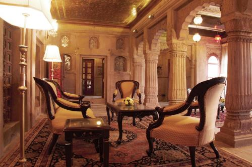 A seating area at BrijRama Palace- A Heritage Hotel