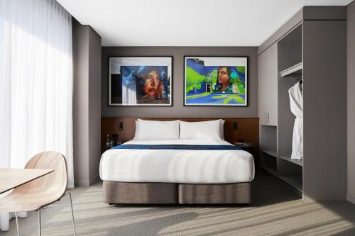 A bed or beds in a room at Art Series - The Adnate