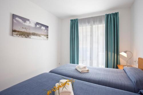Cama o camas de una habitación en Edificio Puerto