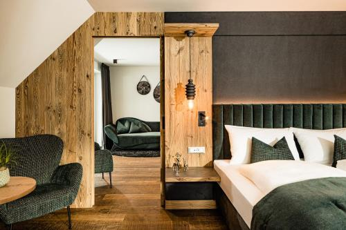 A bed or beds in a room at Hotel Touring Dolomites