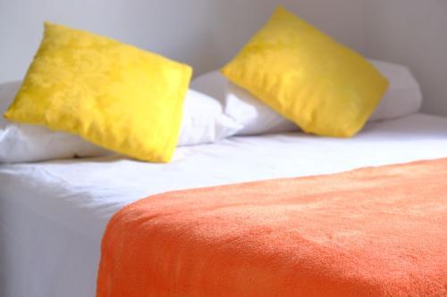 Cama ou camas em um quarto em Aquarela Hostel