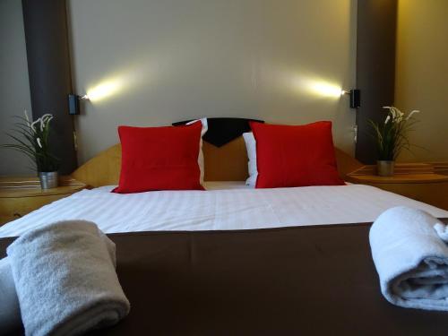 Letto o letti in una camera di Value Stay Brussels South