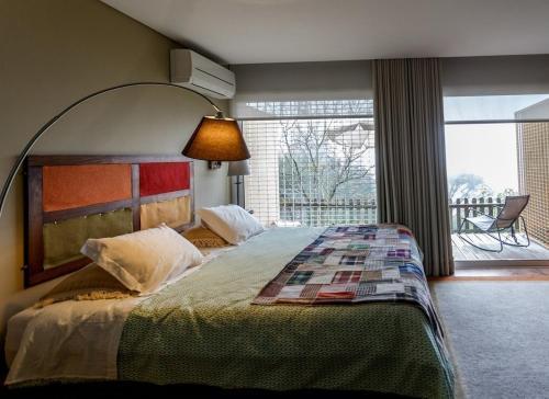 Uma cama ou camas num quarto em Quinta das Leiras