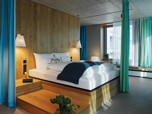 A bed or beds in a room at 25hours Hotel Langstrasse