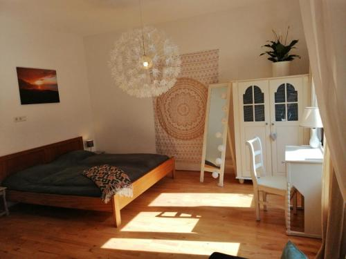 A bed or beds in a room at Drielandenpunt Vaals Aachen - private terrace & sauna