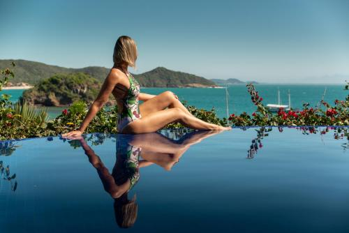 The swimming pool at or near Vila d'este Handmade Hospitality Hotel