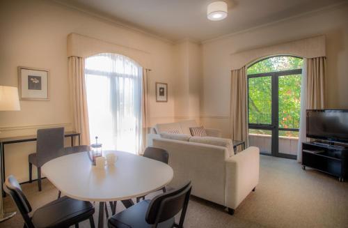 Zona de estar de Majestic Old Lion Apartments