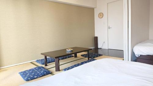 Haruyoshi Cuffe Studio / Vacation STAY 7316にあるベッド