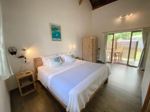 Cama ou camas em um quarto em Fare noanoa