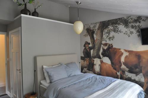 Een bed of bedden in een kamer bij B&B Slotstraat