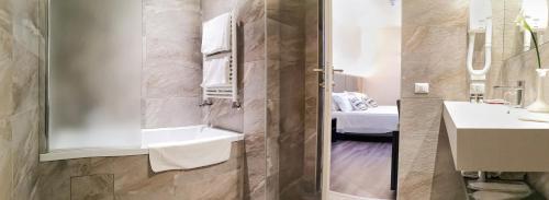 Ванная комната в Hotel Alexander