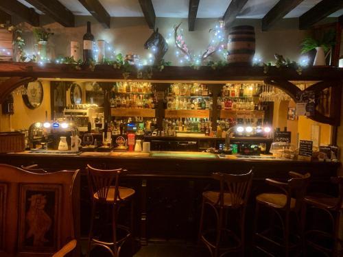 The lounge or bar area at The Horseshoe Inn