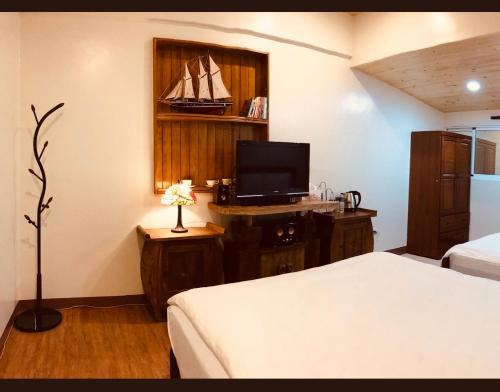 A bed or beds in a room at Grace House Homestay 2