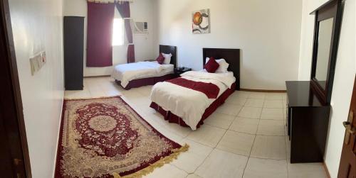 Cama ou camas em um quarto em Orchida Turaif Hotel 2