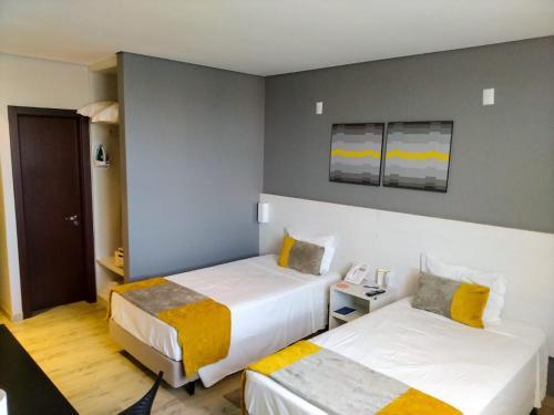 Кровать или кровати в номере Comfort Hotel & Suítes Rondonópolis