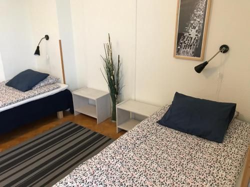 A bed or beds in a room at Gävle Bed & Breakfast