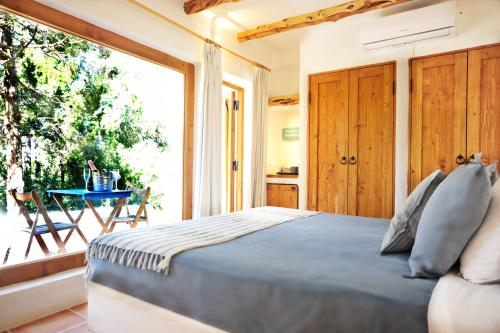 A bed or beds in a room at Can Vistabella Boutique Resort