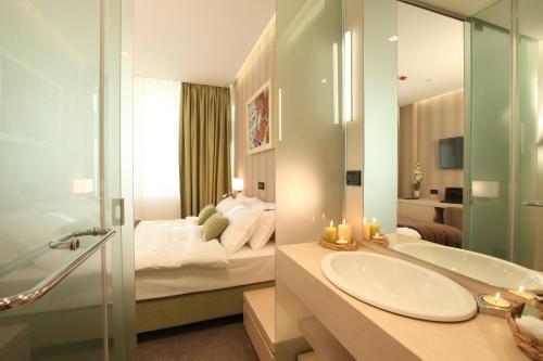 Ванная комната в Hotel Argo