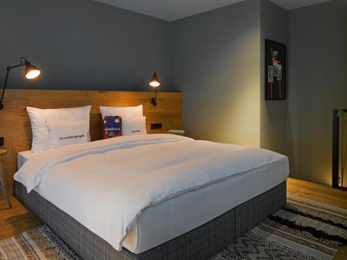A bed or beds in a room at 25hours Hotel The Trip