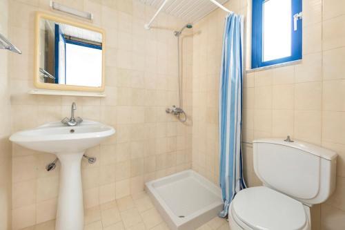 A bathroom at Palm Bay Hotel