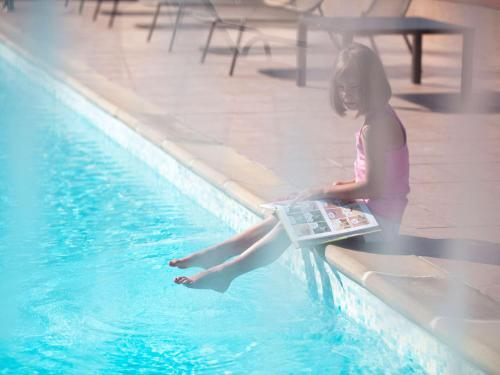 The swimming pool at or near Novotel Bayeux