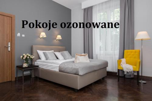 A bed or beds in a room at Grottger Luxury Boutique Hotel City