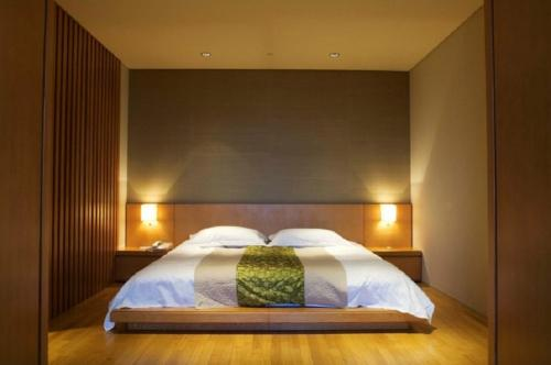 A bed or beds in a room at Hotel Royal Chiao Hsi