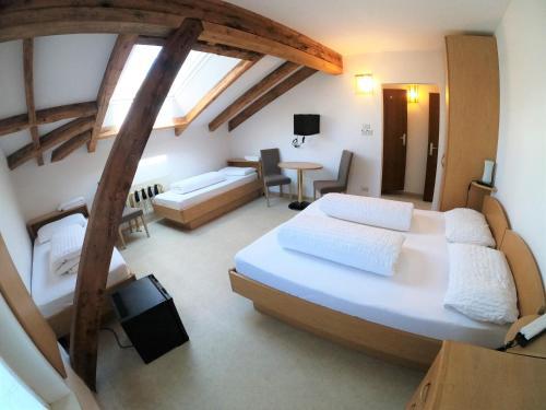 Letto o letti in una camera di Albergo alla Torre Siegler Im Thurm