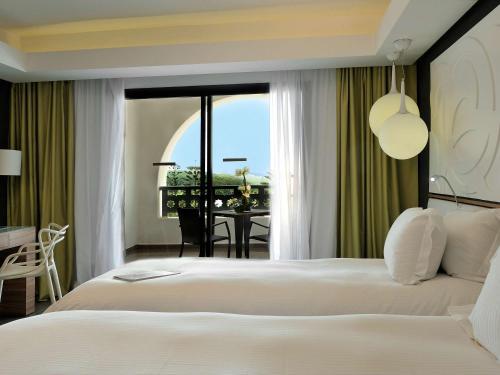 Un ou plusieurs lits dans un hébergement de l'établissement Pullman Mazagan Royal Golf & Spa
