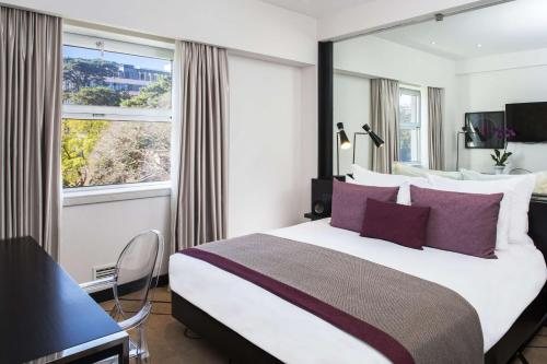 A bed or beds in a room at Avani Avenida Liberdade Lisbon Hotel