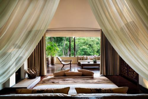A bed or beds in a room at Four Seasons Resort Chiang Mai