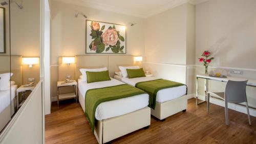 Lova arba lovos apgyvendinimo įstaigoje Hotel Cristoforo Colombo
