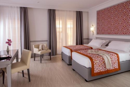 A bed or beds in a room at Hotel Della Conciliazione