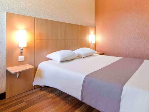 Un ou plusieurs lits dans un hébergement de l'établissement ibis Besançon Marchaux